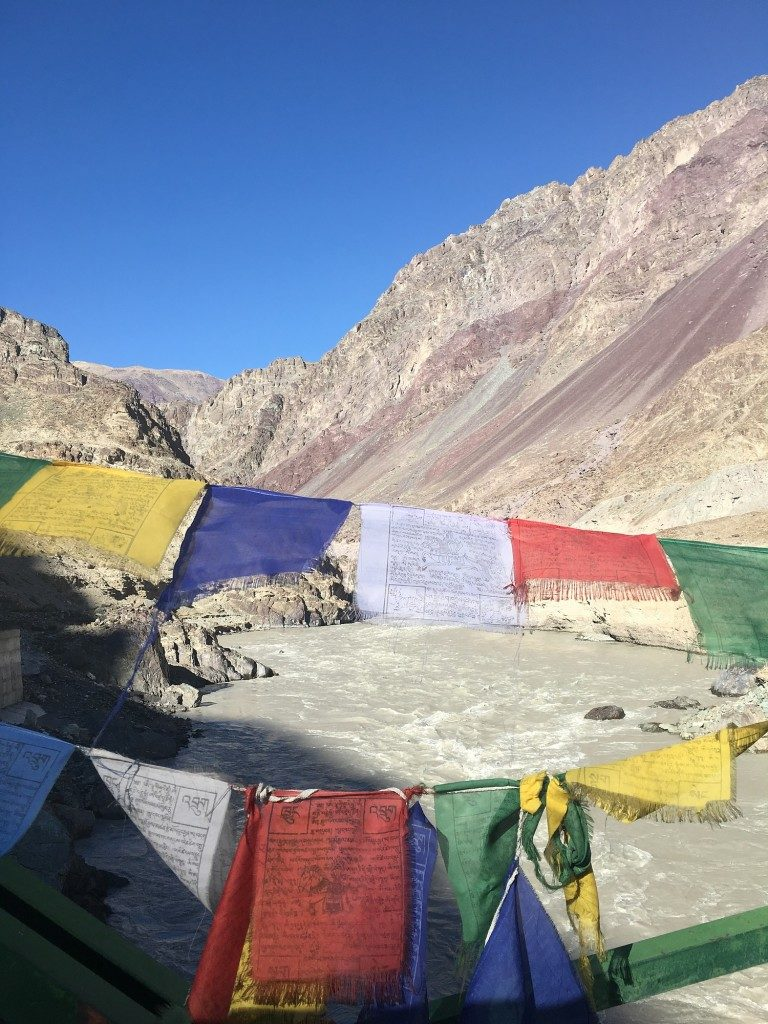 Prayer flags over the Indus River in Ladakh. Photo by Sharon Khan.