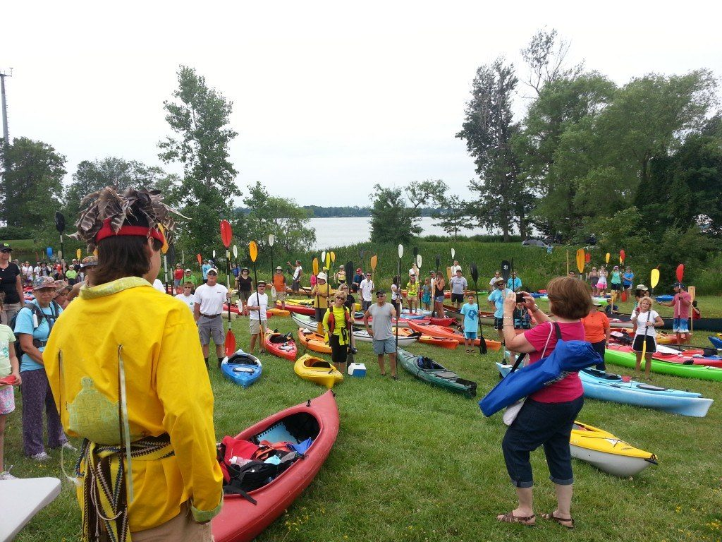 """Community members gather for the kayaking festival """"Paddles Up"""" on Grand Island, an annual water-based event sponsored by Buffalo Niagara Riverkeeper. Photo by Buffalo Niagara Riverkeeper."""