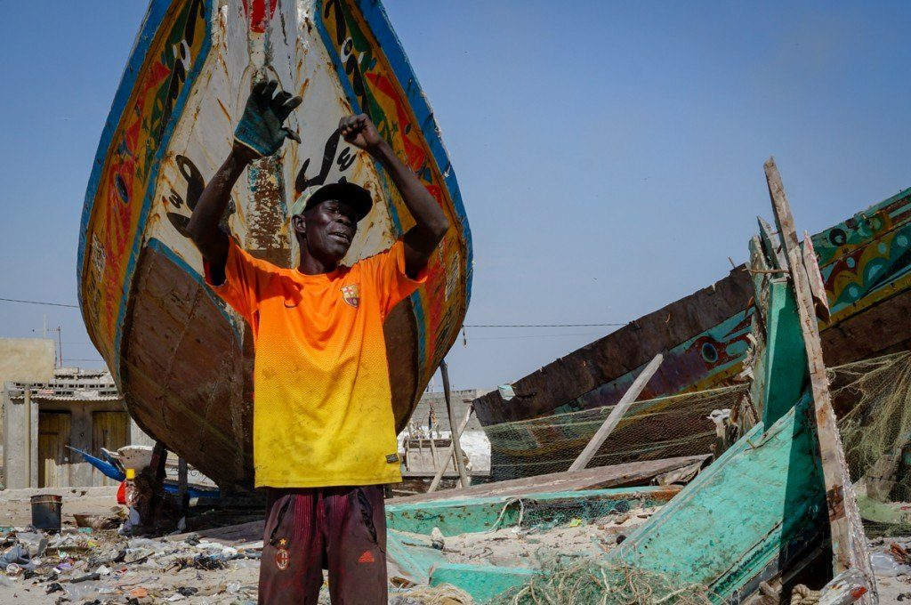 The storms that struck the Senegalese coast in 2014 caused unprecedented damage. A local fisherman in the village of Bargny describes the storm's power, with his re-built fishing boat in the background.
