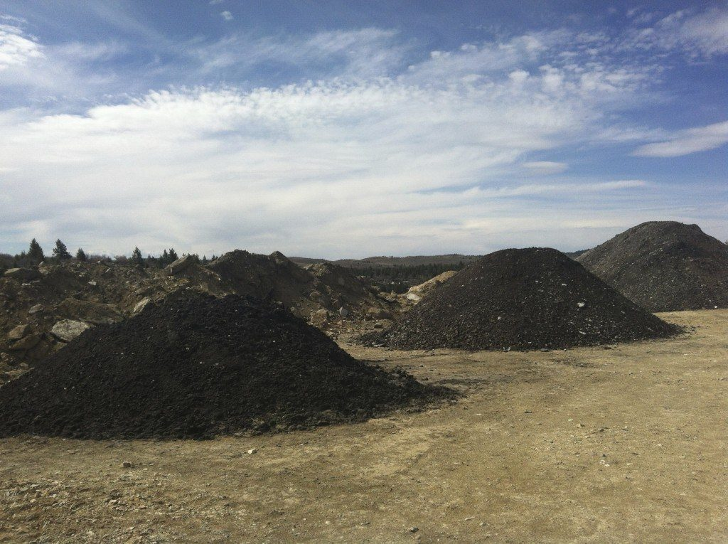 Piles of excavated tar sands ore from the PR Springs strip mine test pit that US Oil Sands hopes to process into fuel. Photo by Lauren Wood.