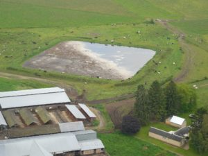 Aerial shot of a manure lagoon.