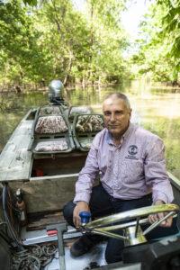 Dean Wilson in his patrol boat