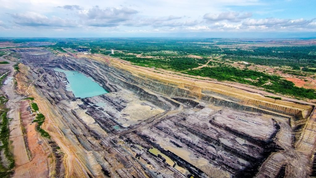One of the smaller open-pit coal mines in Colombia's César Department, only a fraction of the size of Drummond's nearby Pribbenow mine. A witch's brew of toxic heavy metals causes mining wastewater to have a deep teal-blue color.
