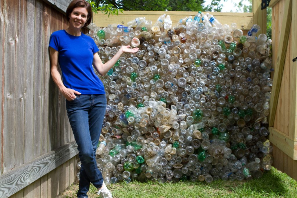 Abby Braman with the first 1,000 plastic bottles collected during a Take2Miss cleanup on the Pearl River at Barnett Reservoir Spillway.
