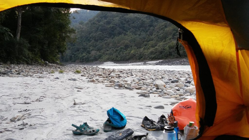 A photo of the river from inside a tent.