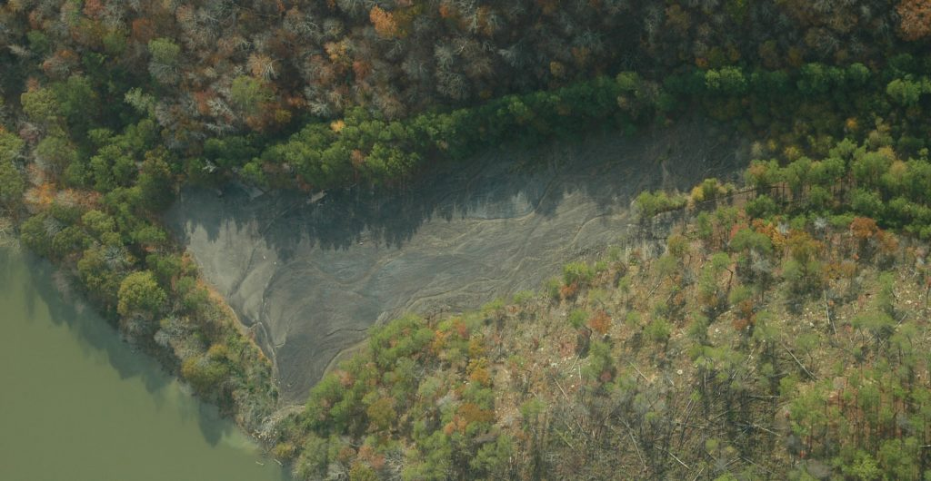 Aerial view of acid mine drainage and polluted runoff from Maxine Mine entering the locust fork of the Black Warrior River.