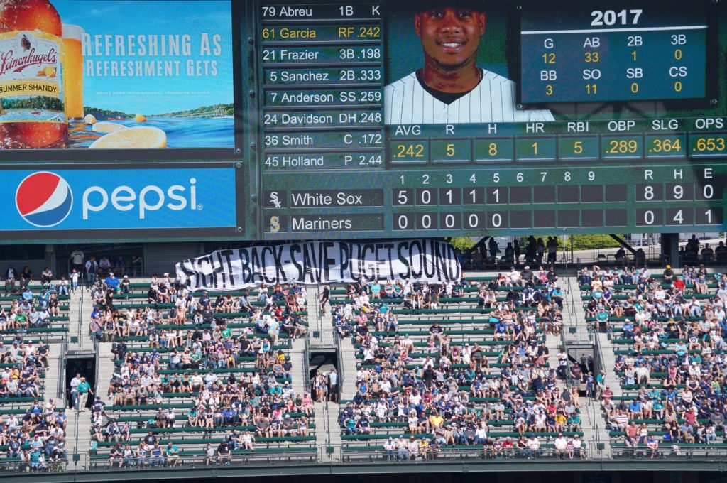 A group from Puget Soundkeeper Alliance joined Sierra Club for a banner drop to show their support for Puget Sound during a White Sox versus Mariners game in May 2017.
