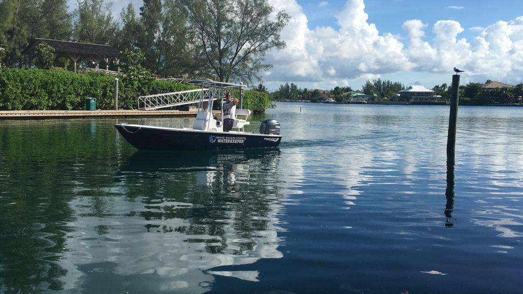 Grand Bahama Coastal Waterkeeper boat & Joseph Darville 2