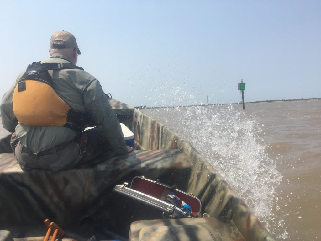 Bruce Bodson, Bayou City Waterkeeper's lead scientist, patrolling near the ExxonMobil refinery site in Upper San Jacinto Bay after the hurricane.
