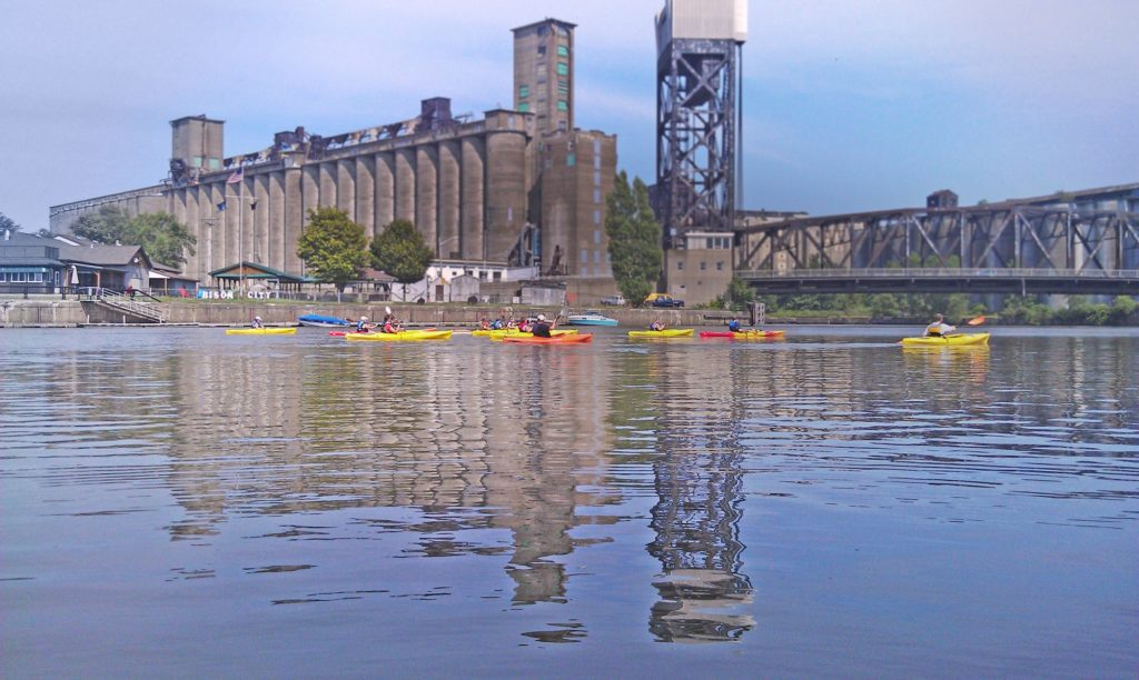 Above, Declared dead in 1967, the Buffalo River is alive today thanks to decades of restoration efforts. Below, In 2017, Buffalo Niagara Waterkeeper attacted thousands of people to the region's waterways through tours, classes and volunteer events.