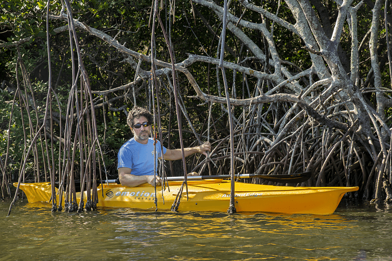 Environmental attorney Justin Bloom sitting in a kayak in the river.
