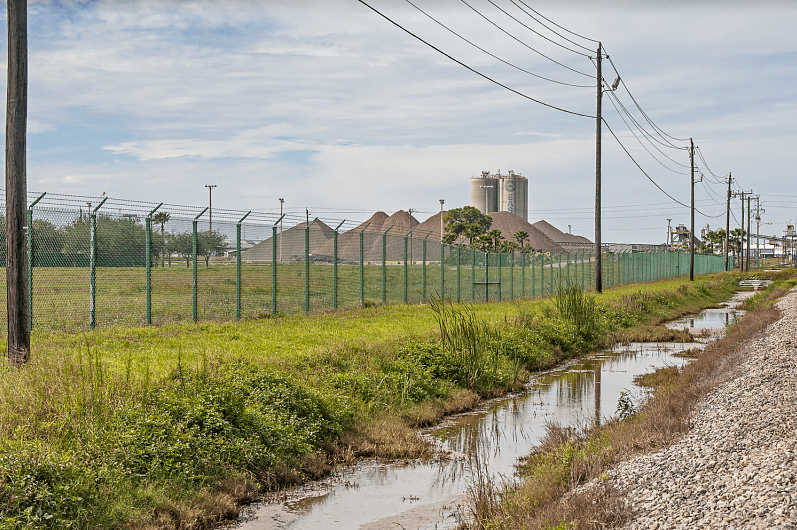 A drainage canal alongside a decommissioned phosphate plant in Port Manatee.