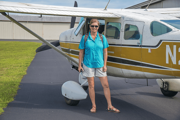 Lisa Rinaman standing in front of a helicopter.