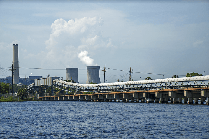The coal-fired Northside Generating Station on the St. John's River in Jacksonville, with coal chutes in the foreground.