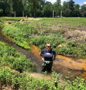 Houstons Bayou City Waterkeeper Jordan Macha conducting stream-wetland restoration training.