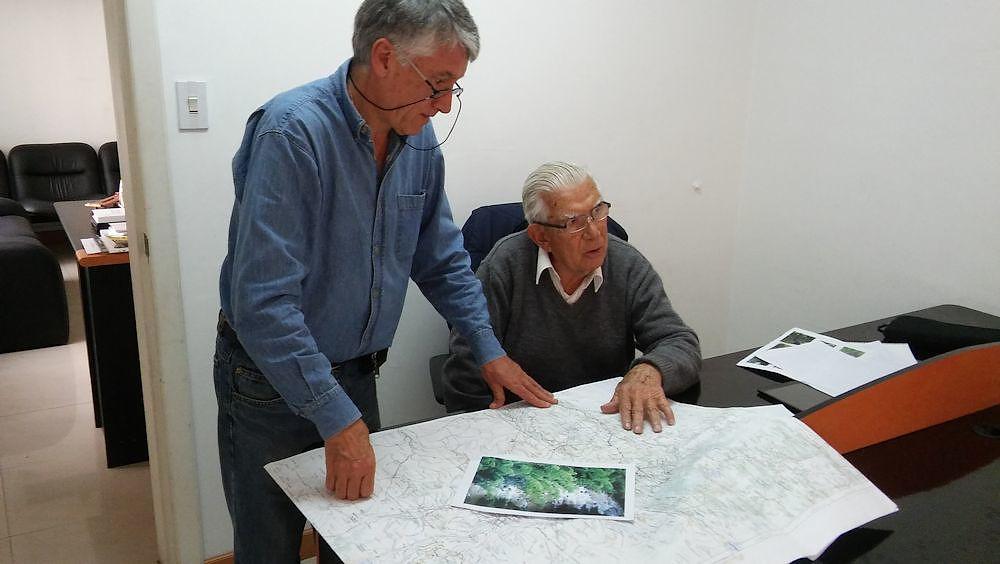 Rafael (right) and Patricio study the map of the Guayllabamba River of northwestern Ecuador.